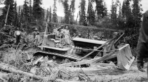 Black soldier operating a bulldozer at Dead Man's Creek in 1942