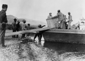 Black soldiers unloading a barge at Morley Bay, Yukon Territory 1942