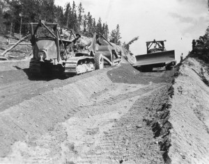 Two dozers grading Alaska Highway 52 miles from Carcross heading toward Johnsons Crossing. 1942
