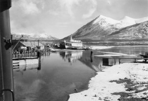 Looking out WP&YT train window at Tutshi Steamboat and Nares Mountain in Carcross, YT. 1942