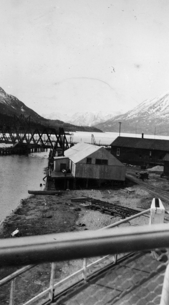 Looking from drydocked Steamboat Tutshi at railroad bridge and Lake Bennett, Carcross, YT. 1942