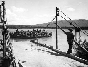 Soldiers of 340th marched to Teslin River, boarded on a barge and headed up Teslin Lake to Morley Bay. 1942
